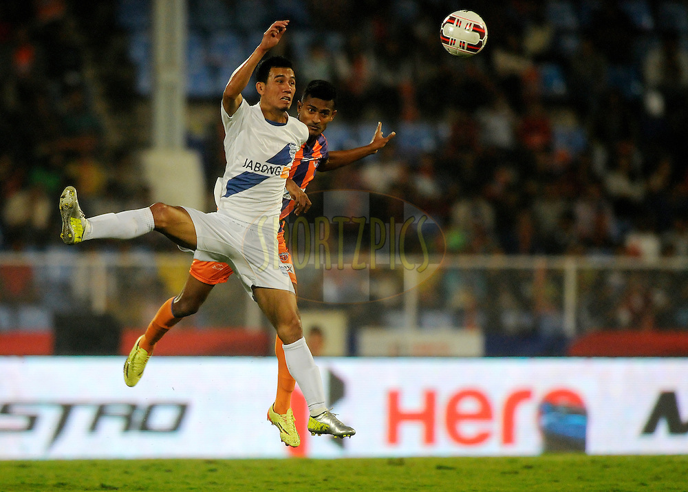 Sushil Kumar Singh of Mumbai City FC and Dharmaraj Ravanan of FC Pune City during match 48 of the Hero Indian Super League between FC Pune City and Mumbai City FC held at the Shree Shiv Chhatrapati Sports Complex Stadium, Pune, India on the 3rd December 2014.<br /> <br /> Photo by:  Pal Pillai/ ISL/ SPORTZPICS