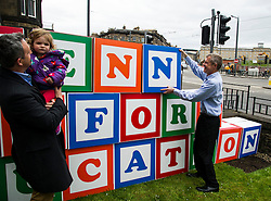 Pictured: Alex Col-Hamilton and his daughter  Darcy helped Willie Rennie build his pledge<br /> <br /> Scottish Liberal Democrat leader Willie Rennie made his final pitch for votes today as he unveiled large building blocks that spelt out the party's flagship &quot;Penny for education&quot; policy. Scottish Liberal Democrats HQ, 4, EH12 5DR. Adam Clarke 07450 980 386.the election on Thursday.<br /> <br /> Ger Harley | EEm 2 May 2016