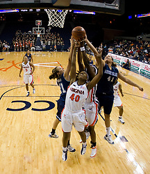 Virginia guard Enonge Stovall (40) fights for a rebound with Rhode Island center Whitney Hollis (41) and Rhode Island guard Amanda McGrew (21).  The Virginia Cavaliers women's basketball team defeated the Rhode Island Rams 89-53 at the John Paul Jones Arena in Charlottesville, VA on January 9, 2008.