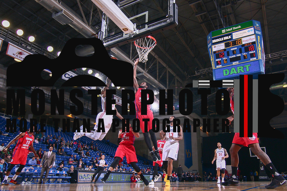 Delaware 87ers Guard CAT BARBER (1) as Grand Rapids Drive Guard CHRIS ANDERSON (24) defends in the first half of a NBA D-league regular season basketball game between the Delaware 87ers and the Grand Rapids Drive (Detroit Pistons) Tuesday. Nov. 29, 2016 at The Bob Carpenter Sports Convocation Center in Newark, DEL.