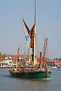 Great Britain England Essex Maldon River Blackwater Hythe Quay Traditional Thames Sailing Barges tied up at Quay. Thames Sailing Barge leaving on the high tide
