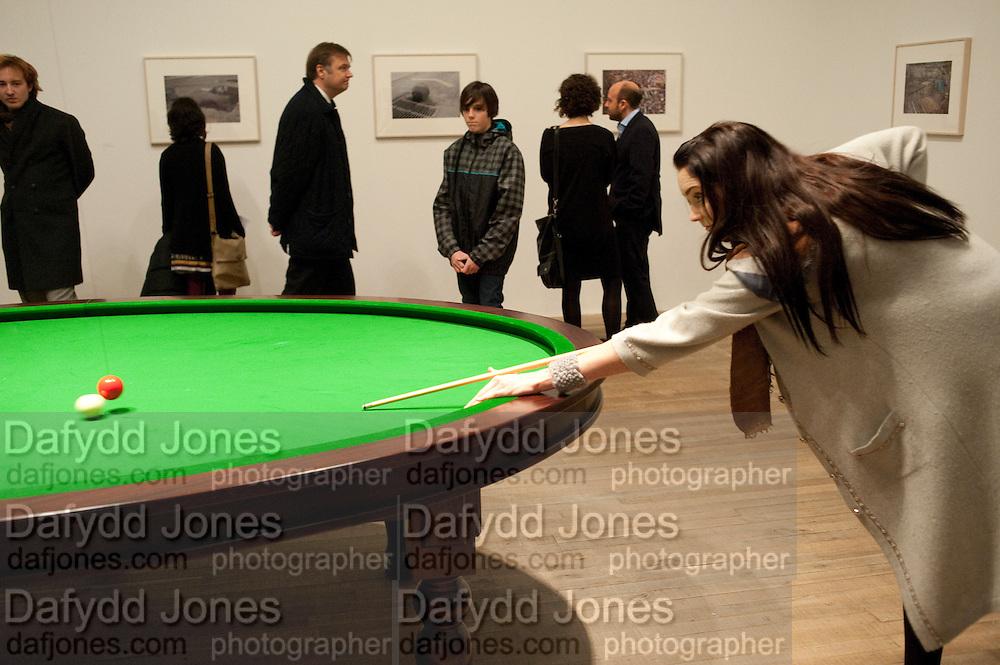 LILY COLE, PLAYING Gabriel Orozco's 'Carambole with a Pendulum? Gabriel Orozco reception, Tate Modern, London. 18 January 2010. .-DO NOT ARCHIVE-© Copyright Photograph by Dafydd Jones. 248 Clapham Rd. London SW9 0PZ. Tel 0207 820 0771. www.dafjones.com.