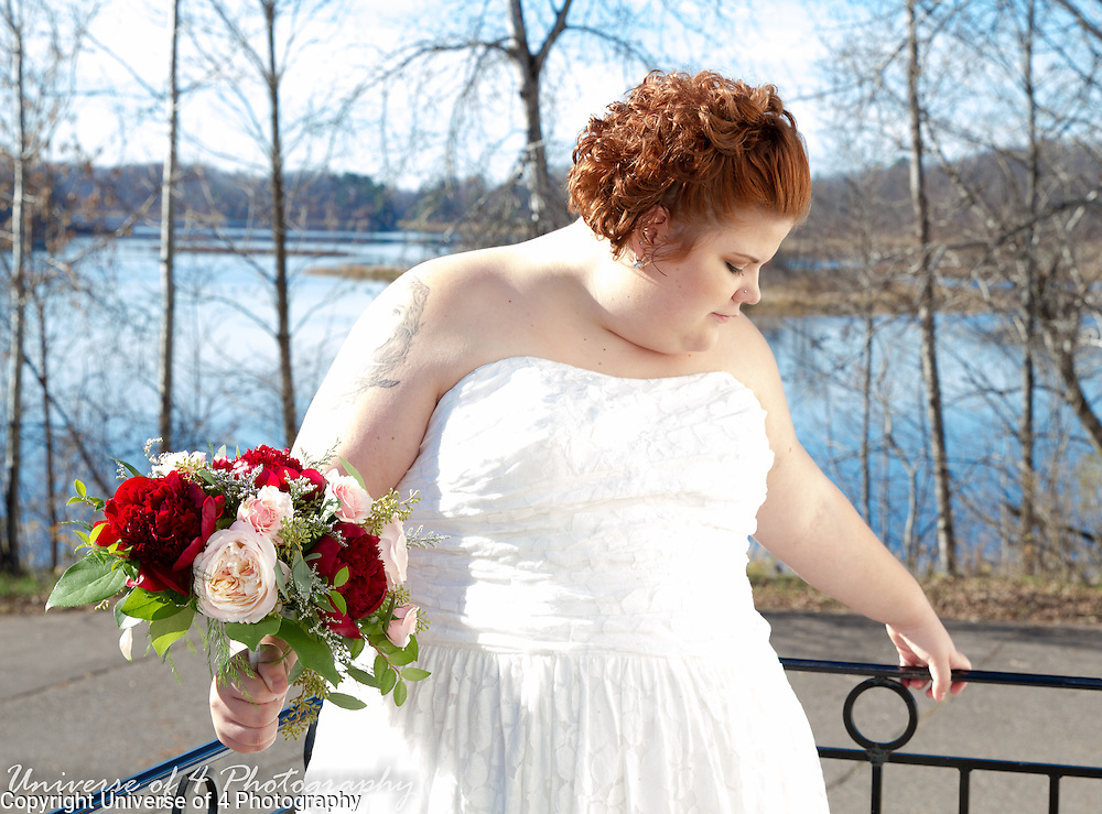 A beautiful bride enjoying the fabulous November sunshine in Finlayson, Minnesota. The fabulous venue and beautiful weather enabled us to capture the ceremony from inside and out.