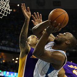 April 28, 2011; New Orleans, LA, USA; New Orleans Hornets power forward Carl Landry (24) is fouled by Los Angeles Lakers small forward Matt Barnes (9) during the fourth quarter in game six of the first round of the 2011 NBA playoffs at the New Orleans Arena. The Lakers defeated the Hornets 98-80 to advance to the second round of the playoffs.   Mandatory Credit: Derick E. Hingle