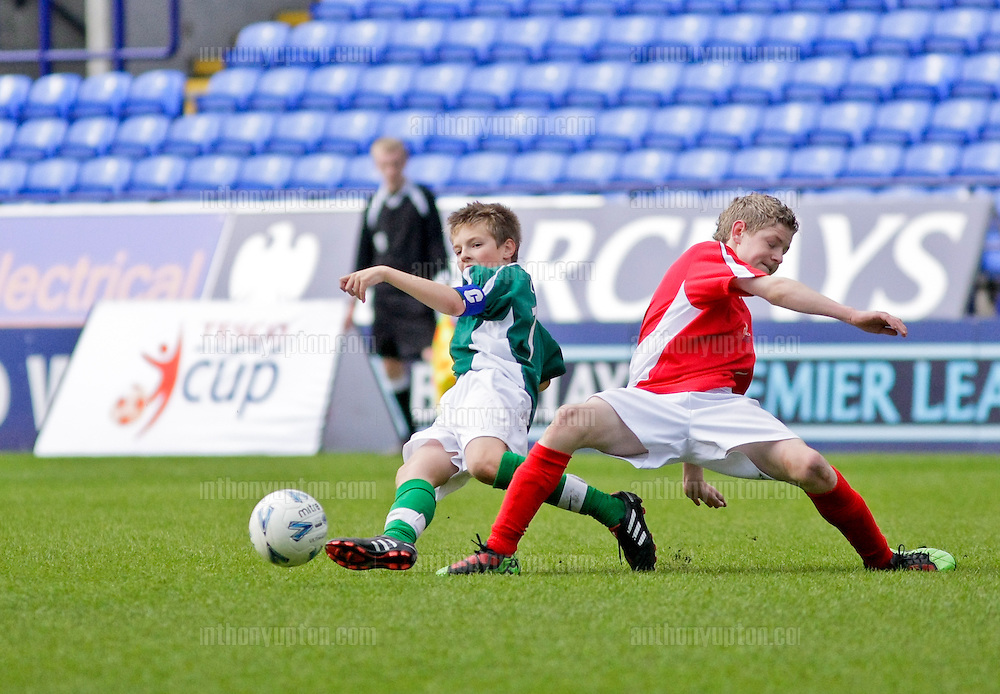 20100516                 Copyright image 2010©.Mostyn Dragons U13 v Linfield FC.Tesco Football Cup Final at the Reebok Stadium in Bolton .Mandatory Credit Ant Upton otherwise additional charges will apply..For photographic enquiries please call Anthony Upton 07973 830 517 or email info@anthonyupton.com .This image is copyright Anthony Upton 2010©..This image has been supplied by Anthony Upton and must be credited Anthony Upton. The author is asserting his full Moral rights in relation to the publication of this image. All rights reserved. Rights for onward transmission of any image or file is not granted or implied. Changing or deleting Copyright information is illegal as specified in the Copyright, Design and Patents Act 1988. If you are in any way unsure of your right to publish this image please contact Anthony Upton on +44(0)7973 830 517 or email: