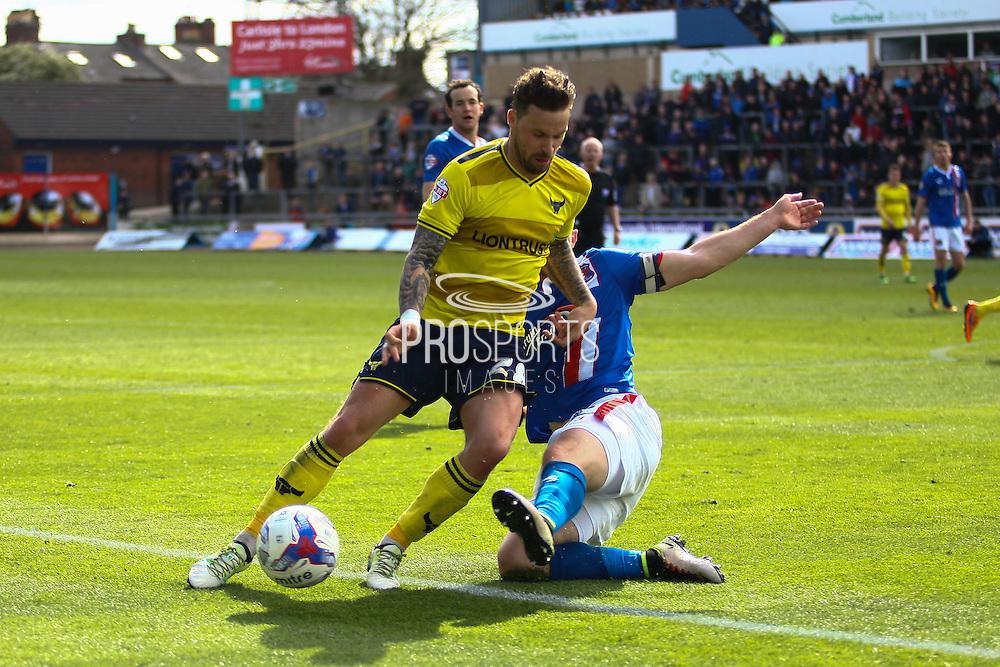 Carlisle United Defender Danny Grainger making a vital challenge during the Sky Bet League 2 match between Carlisle United and Oxford United at Brunton Park, Carlisle, England on 30 April 2016. Photo by Craig McAllister.