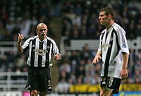 Photo: Andrew Unwin.<br /> Newcastle United v Sheffield United. The Barclays Premiership. 04/11/2006.<br /> Newcastle's Stephen Carr (L) questions a pass from his team-mate, James Milner (R).