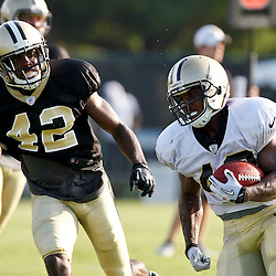 July 29, 2012; Metairie, LA, USA; New Orleans Saints running back Darren Sproles (43) runs from safety Isa Abdul-Quddus (42) during a training camp practice at the team's practice facility. Mandatory Credit: Derick E. Hingle-US PRESSWIRE