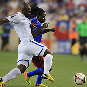 Leonel Saint-Preux, Haiti, is challenged by Osman Chávez, Honduras, (left), during the Haiti V Honduras CONCACAF Gold Cup group B football match at Red Bull Arena, Harrison, New Jersey. USA. 8th July 2013. Photo Tim Clayton