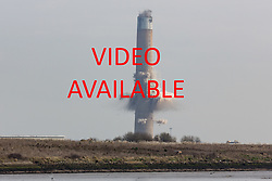 VIDEO AVAILABLE AT https://tinyurl.com/y8edk5qy © Licensed to London News Pictures. 22/03/2018. Gillingham, UK. The main chimney has been demolished at Kingsnorth Power Station in Hoo, Kent, as seen from across the River Medway in Gillingham. Photo credit : Rob Powell/LNP
