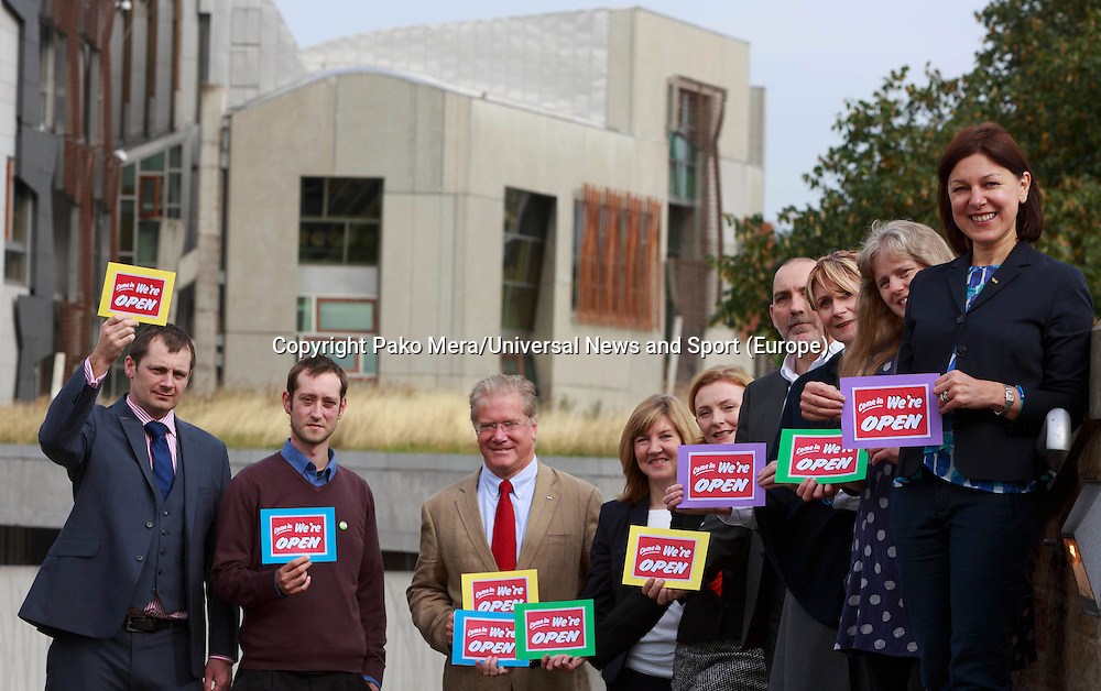 L-R Steven Ransay, Malcolm Wadia, Iain Taylor, Alison Johnstone, Alex Lambert, David Brook, Jane W Denholm, Lari Don and Jil Murphy posing for a photos taken in the Dynamic Earth. <br /> Green MSP to hit independence referendum trail. Alison Johnstone to highlight how voting Yes on September 18 could help set up a small business revolution in the Dynamic Earth, Edinburgh.<br /> Pako Mera/Universal News And Sport (Europe) 09/09/2014
