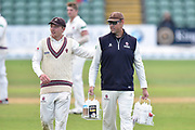 Marcus Trescothick of Somerset gets a pat on the back from Dom Bess of Somerset as he carries the drinks bottles on his last day as a player during the Specsavers County Champ Div 1 match between Somerset County Cricket Club and Essex County Cricket Club at the Cooper Associates County Ground, Taunton, United Kingdom on 26 September 2019.