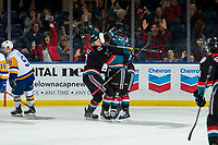 KELOWNA, CANADA - DECEMBER 1: Dalton Gally #3 hugs Mark Liwiski #9 of the Kelowna Rockets after he scores a second period goal triggering the annual teddy bear toss against the Saskatoon Blades  on December 1, 2018 at Prospera Place in Kelowna, British Columbia, Canada.  (Photo by Marissa Baecker/Shoot the Breeze)