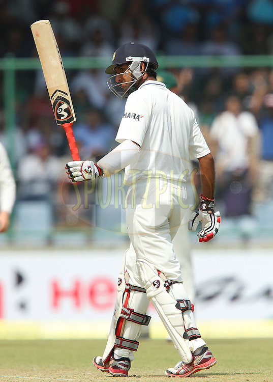 Cheteshwar Pujara of India celebrates his fifty during day 2 of the 4th Test Match between India and Australia held at the Feroz Shah Kotla stadium in Delhi on the 23rd March 2013..Photo by Ron Gaunt/BCCI/SPORTZPICS ..Use of this image is subject to the terms and conditions as outlined by the BCCI. These terms can be found by following this link:..http://www.sportzpics.co.za/image/I0000SoRagM2cIEc