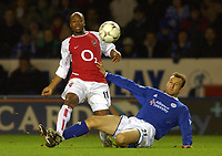 Photo. Matthew Lewis.<br />Leicester City v Arsenal. FA Barclaycard Premiership. 06/12/2003.<br /><br />Leicester's Riccy Scimeca tackles Arsenal's Sylvain Wiltord.