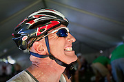 Tim Inall of Ridgefield, CT grimaces in pain in the transition tent following the swim portion of the Ford Ironman Coeur d'Alene due to a muscle cramp...