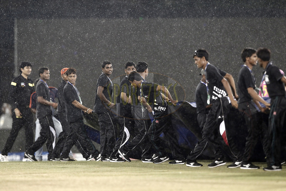 Groundsmen cover the pitch to protect from rain during match 3 of the Oppo Champions League Twenty20 between the Cape Cobras and the Northern Knights held at the Chhattisgarh International Cricket Stadium, Raipur, India on the 19th September 2014<br /> <br /> Photo by:  Deepak Malik / Sportzpics/ CLT20<br /> <br /> <br /> Image use is subject to the terms and conditions as laid out by the BCCI/ CLT20.  The terms and conditions can be downloaded here:<br /> <br /> http://sportzpics.photoshelter.com/gallery/CLT20-Image-Terms-and-Conditions-2014/G0000IfNJn535VPU/C0000QhhKadWcjYs
