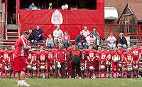 """Coach Chip Nyhan pauses for a moment of silence as the Laconia Middle School football team donning """"pink socks"""" dedicate their game on Saturday against Monadnock to raise funds and awareness for Breast Cancer Research.  (Karen Bobotas/for the Laconia Daily Sun)"""