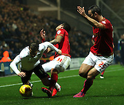 Joe Garner and Daniel Pinillos battle during the Sky Bet Championship match between Preston North End and Nottingham Forest at Deepdale, Preston, England on 3 November 2015. Photo by Pete Burns.