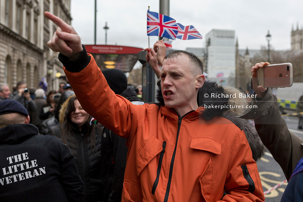 After threee and a half years of political upheavel in the British parliament, a young man shouts insults at Pro-EU Remainers as Brexiteers celebrate in Westminster on Brexit Day, the day when the UK legally leaves the European Union, on 31st January 2020, in London, England.