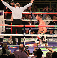 Picture by Richard Gould/Focus Images Ltd +44 7855 403186<br /> 02/11/2013<br /> Coyle (black &amp; Gold) celebrates as the ref stops the fight at Hull Ice Arena, Hull.