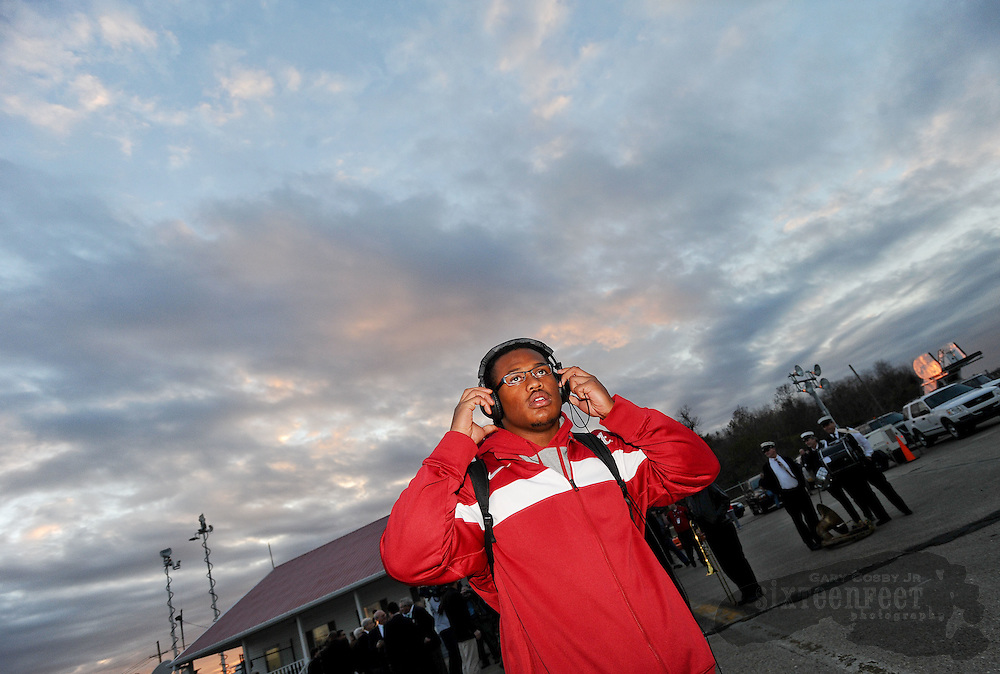 Daily Photo by Gary Cosby Jr.    ..The University of Alabama football arrives at the Louis Armstrong International Airport Wednesday afternoon as they begin the final preparations for the BCS Championship Game against conference rival LSU.  Dont'a Hightower dons headphones as he leaves an arrival news conference and makes his way to a waiting team bus...................................