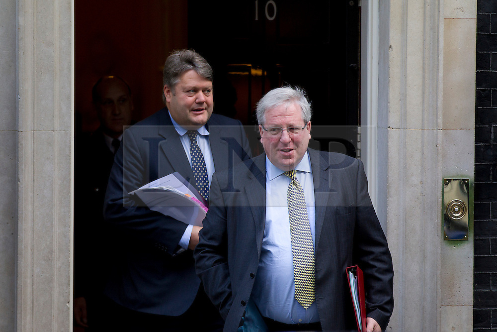 © Licensed to London News Pictures. 16/10/2012. LONDON, UK. Patrick McLoughlin (R), the Transport Secretary, is seen leaving number 10 Downing Street with Lord Strathclyde, Leader of the Lords, after today's meeting of David Cameron's cabinet in London today (16/10/12). Photo credit: Matt Cetti-Roberts/LNP