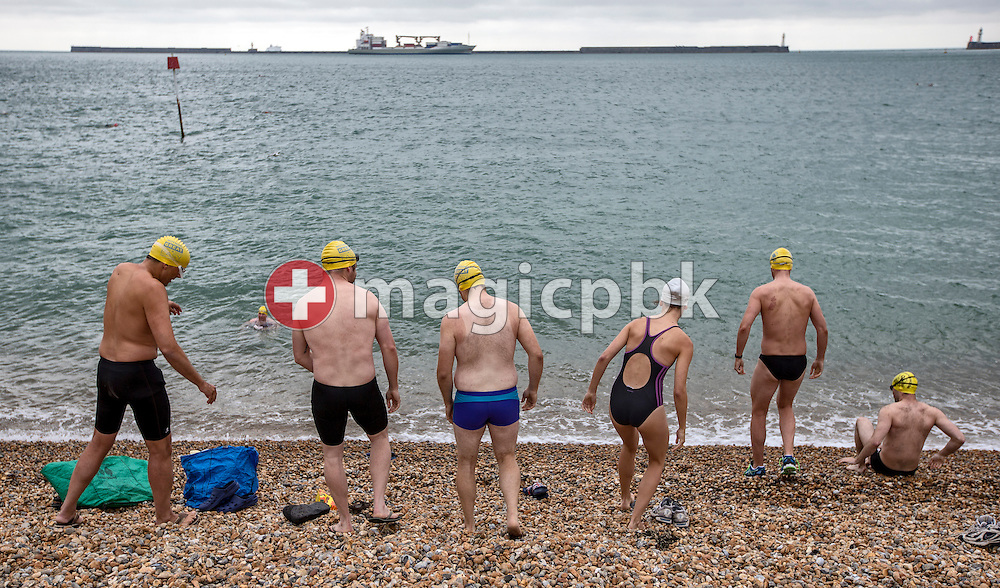 Swimmers on their way in the sea for a training session at the harbour in Dover, Great Britain, Saturday, Aug. 17, 2013. Gino Deflorian tries to become the first Swiss male swimmer who successfully swims the English Channel form Dover/Folkestone to Calais, France. (Photo by Patrick B. Kraemer / MAGICPBK)