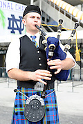 January 7, 2013: Colin a Notre Dame fan plays the bagpipes before the start of the Discover BCS National Championship game between the Alabama Crimson Tide and the Notre Dame Fighting Irish at Sun Life Stadium in Miami Gardens, Fl