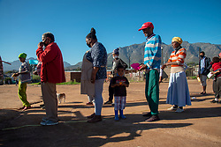 Social distancing at a volunteer food drive in Mountain View, an informal settlement in Jamestown, located in the Cape Winelands District, on Saturday, May 29, 2020. It's estimated that most, if not all, of the households here had no income, due to unemployement during lockdown. Cape Winelands is one of the districts in the Western Cape that has been designated a hotspot area, in terms of people testing positive for COVID-19. When South Africa moves down to Stage 3 of the nationwide lockdown on June 1st, hotspots areas will remain under stricter regulation and surveillance, per the latest government announcements. PHOTO: EVA-LOTTA JANSSON