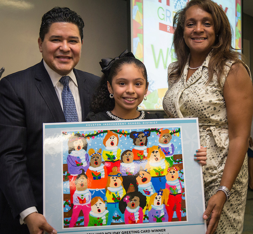 Superintendent Richard Carranza and HISD Trustee Rhonda Skillern-Jones pose with Ed White Elementary School fourth-grader Angela Ramos, who won in the elementary division.