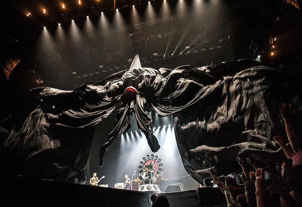 A curtain unveils the Foo Fighters as they take the stage at Xcel Energy Center in St. Paul August 22, 2015.