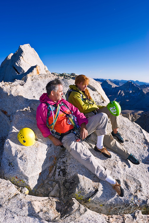 Climbers on the summit of Bear Creek Spire, John Muir Wilderness, Sierra Nevada Mountains, California