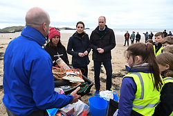 The Duke and Duchess of Cambridge join primary school pupils in a beach clean-up during a visit to Newborough Beach in North Wales.
