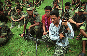 "Maoist soldiers demonstrate their weapons training at a rural rebel camp deep within Maoist country.  ""We want peace,"" a Maoist commander states.  ""We want wisdom and freedom for our people.  Right now we are in a fighting place, but when we win, we may provide these things.  Our Nepali people are not educated; we are trying to do more for educating the people.""www.crystalstreet.net"