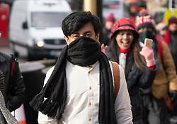 Edinburgh, Scotland, UK. 11 March, 2020. Asian tourists wearing face masks on the Royal Mile in Edinburgh today. Scotland, UK