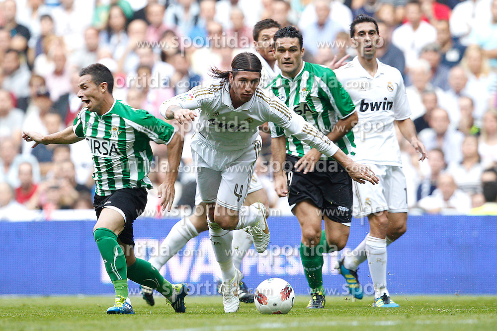 15.10.2011, Estadio Santiago Bernabeu, Madrid, ESP, Primera Division, Real Madrid vs Real Betis, im Bild Real Madrid's Sergio Ramos and Betis' Molina// during Primera Division football match between Real Madrid and Real Betis at Santiago Bernabeu Stadium, Madrid, Spain on 15/10/2011. EXPA Pictures © 2011, PhotoCredit: EXPA/ Alterphoto/ Cesar Cebolla +++++ ATTENTION - OUT OF SPAIN/(ESP) +++++