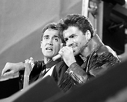 Pop duo Wham partners, Andrew Ridgeley (l) and George Michael, on stage at Wembley Stadium for their sell-out farewell concert.