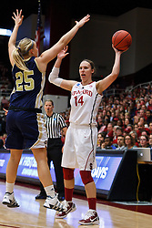 March 19, 2011; Stanford, CA, USA; Stanford Cardinal forward Kayla Pedersen (14) is defended by UC Davis Aggies guard/forward Kasey Riecks (25) during the first half of the first round of the 2011 NCAA women's basketball tournament at Maples Pavilion.