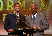 Dec 20, 2018; San Antonio, TX, USA; Herman Frazier (right) presents Michael Norman with the Bowerman Trophy at the 10th Bowerman Awards at the JW Marriott San Antonio Hill Country Resort & Spa.