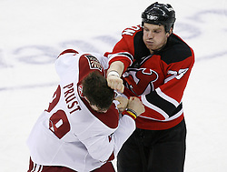 Mar 12, 2009; Newark, NJ, USA; New Jersey Devils right wing David Clarkson (23) lands a right hand to the head of Phoenix Coyotes right wing Brandon Prust (29) during the third period at the Prudential Center. The Devils defeated the Coyotes 5-2, and New Jersey Devils goalie Martin Brodeur (30) moved to within one win of tying Patrick Roy for the all-time win record.