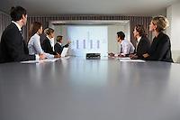 Businessman Giving Presentation in Conference Room