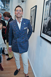 Designer GUY HILLS at a private view of portrait photographs by Debbi Clark in support of the Sir Hubert von Herkomer Arts Foundation, held at The Strand Gallery, 32 John Adam Street, London WC2Non 8th May 2013.