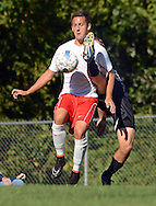 LANGHORNE, PA - SEPTEMBER 22: Neshaminy's Kenny Herrmann #7 knees the soccer ball as Central Bucks South's Evan Fawlkowski #3 kicks at it in the first half September 22, 2014 in Langhorne, Pennsylvania. (Photo by William Thomas Cain/Cain Images)