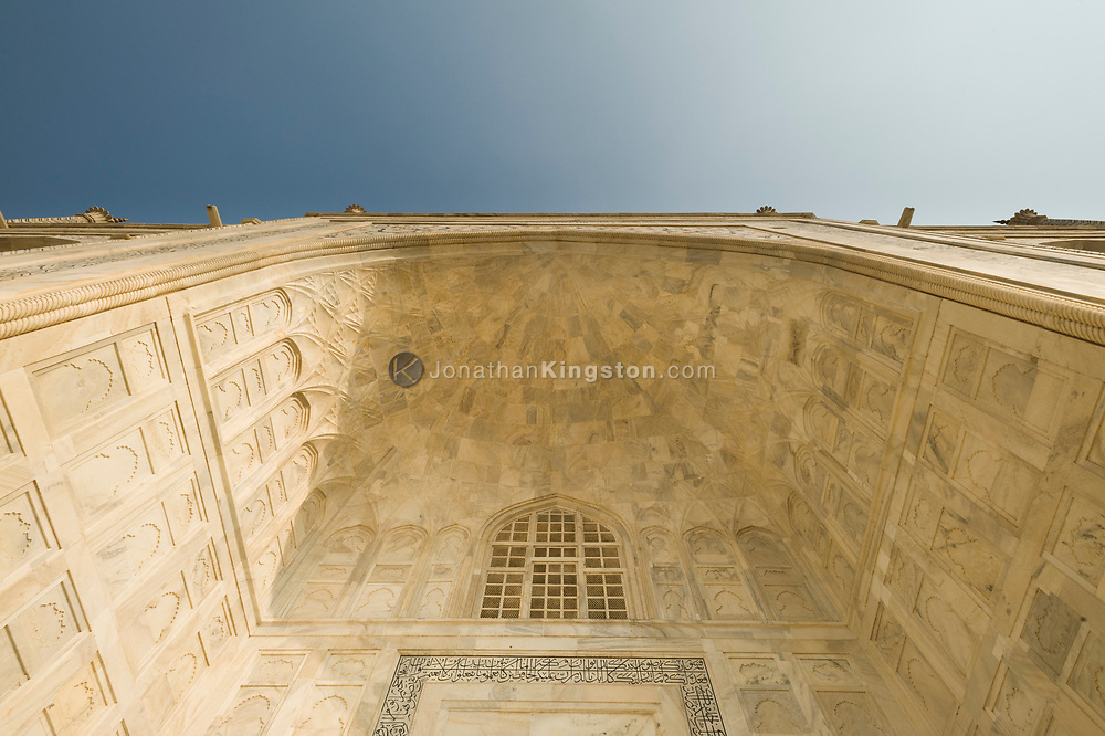 Low angle view of a pishtaq on the tomb of the Taj Mahal, Agra, India.