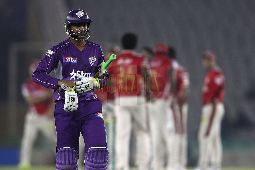 Shoaib Malik of the Hobart Hurricanes walks back to the dug out after losing his wicket during match 2 of the Oppo Champions League Twenty20 between the Kings XI Punjab and the Hobart Hurricanes held at the Punjab Cricket Association Stadium, Mohali, India on the 18th September 2014<br /> <br /> Photo by:  Shaun Roy / Sportzpics/ CLT20<br /> <br /> <br /> Image use is subject to the terms and conditions as laid out by the BCCI/ CLT20.  The terms and conditions can be downloaded here:<br /> <br /> http://sportzpics.photoshelter.com/gallery/CLT20-Image-Terms-and-Conditions-2014/G0000IfNJn535VPU/C0000QhhKadWcjYs