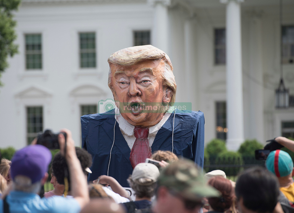 April 29, 2017 - Washington, District of Columbia, U.S - A character of President Trump is displayed in front of the White House during the People's Climate March. (Credit Image: © Robin Loznak via ZUMA Wire)