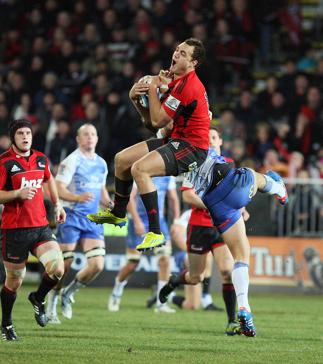 Crusaders Israel Dagg takes high ball against the Force in the Super 15 rugby match at ANZ Stadium, Christchurch, Saturday, July 14, 2012. Credit:SNPA / Dianne Manson