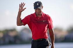 February 25, 2018 - Palm Beach Gardens, Florida, U.S. - Tiger Woods waves to the crowd after completing the 18th hole during the final round of the 2018 Honda Classic at PGA National Resort and Spa in Palm Beach Gardens, Fla., on Sunday, February 25, 2018. (Credit Image: © Andres Leiva/The Palm Beach Post via ZUMA Wire)