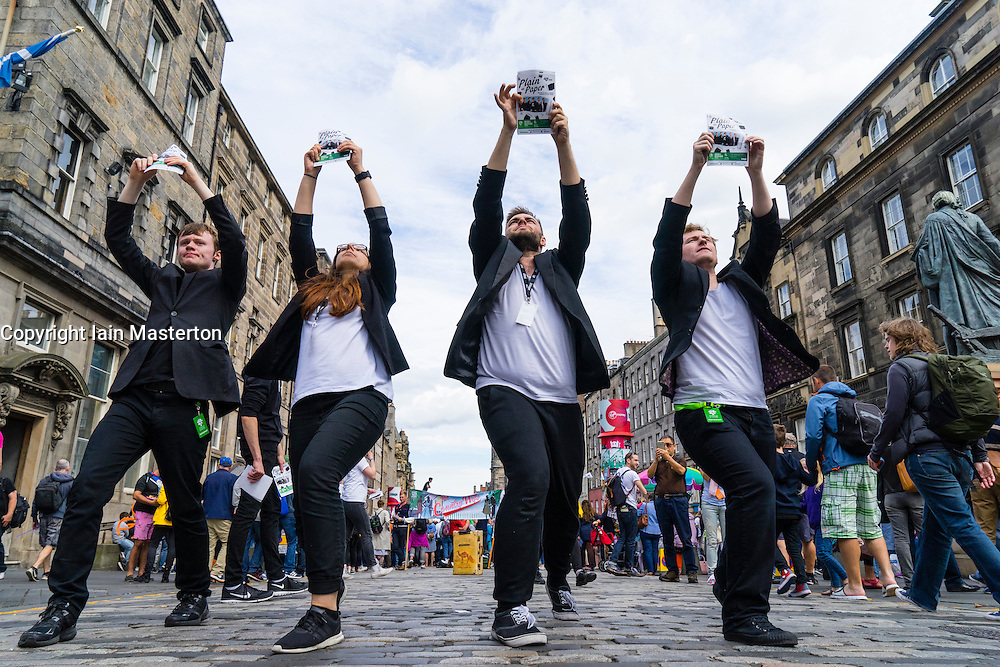 "Actors from GLT Theatre Group promoting production ""Plain as Paper"" on  High Street during Edinburgh Fringe Festival 2016 in Scotland , United Kingdom"